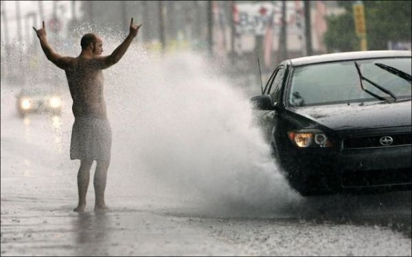 misc-man-getting-splashed-by-car